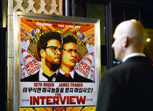 "Image Credit: Reuters/Kevork Djansezian/Files (Shown: A security guard stands at the entrance of United Artists theater during the premiere of the film ""The Interview"" in Los Angeles, California in this December 11, 2014 file photo)"